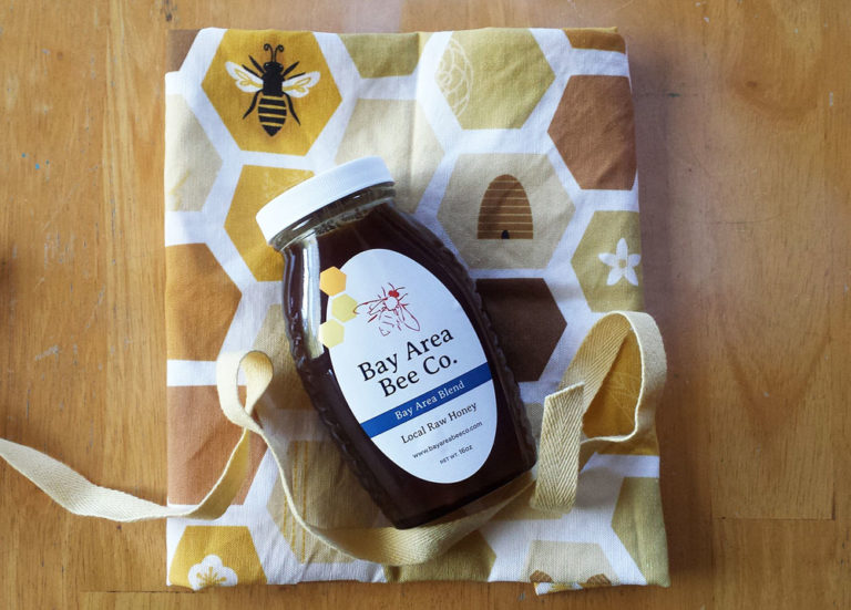 Jar of honey gift wrapped with Honeycomb tea towel by Lellobird